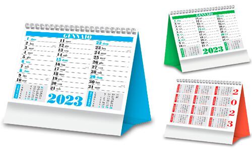 Calendario da tavolo con grafica nei colori, rosso, verde, blu.